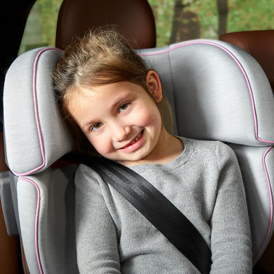 Girl sitting in the UPPAbaby ALTA Booster Car Seat in Sasha