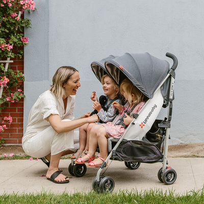 Mom with two daughters in the UPPAbaby G-LINK 2 Double Stroller
