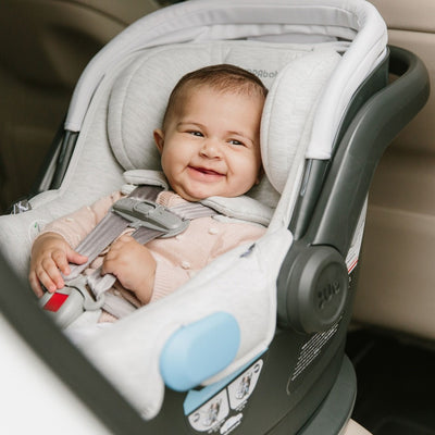 Baby sitting in the UPPAbaby MESA Infant Car Seat in Bryce