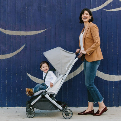 Mom pushing the UPPAbaby Minu stroller in Devin