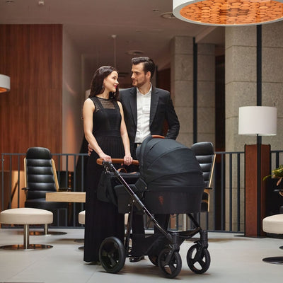 Mom pushing the Venicci Gusto 2 in 1 Stroller in Black