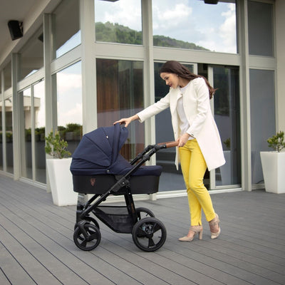 Mom pushing the Venicci Gusto Stroller in Navy
