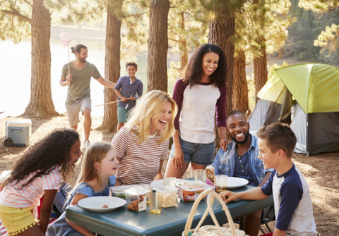A group of people enjoying a picnic in the woods