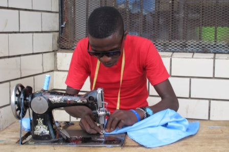 My WYM making cushions in Malawi