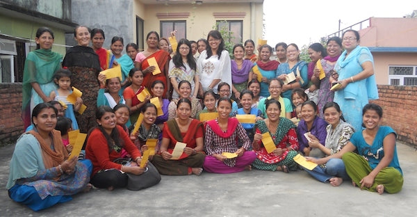 Our skilled craftswomen who hand-sewn all of our applique designs in Nepal