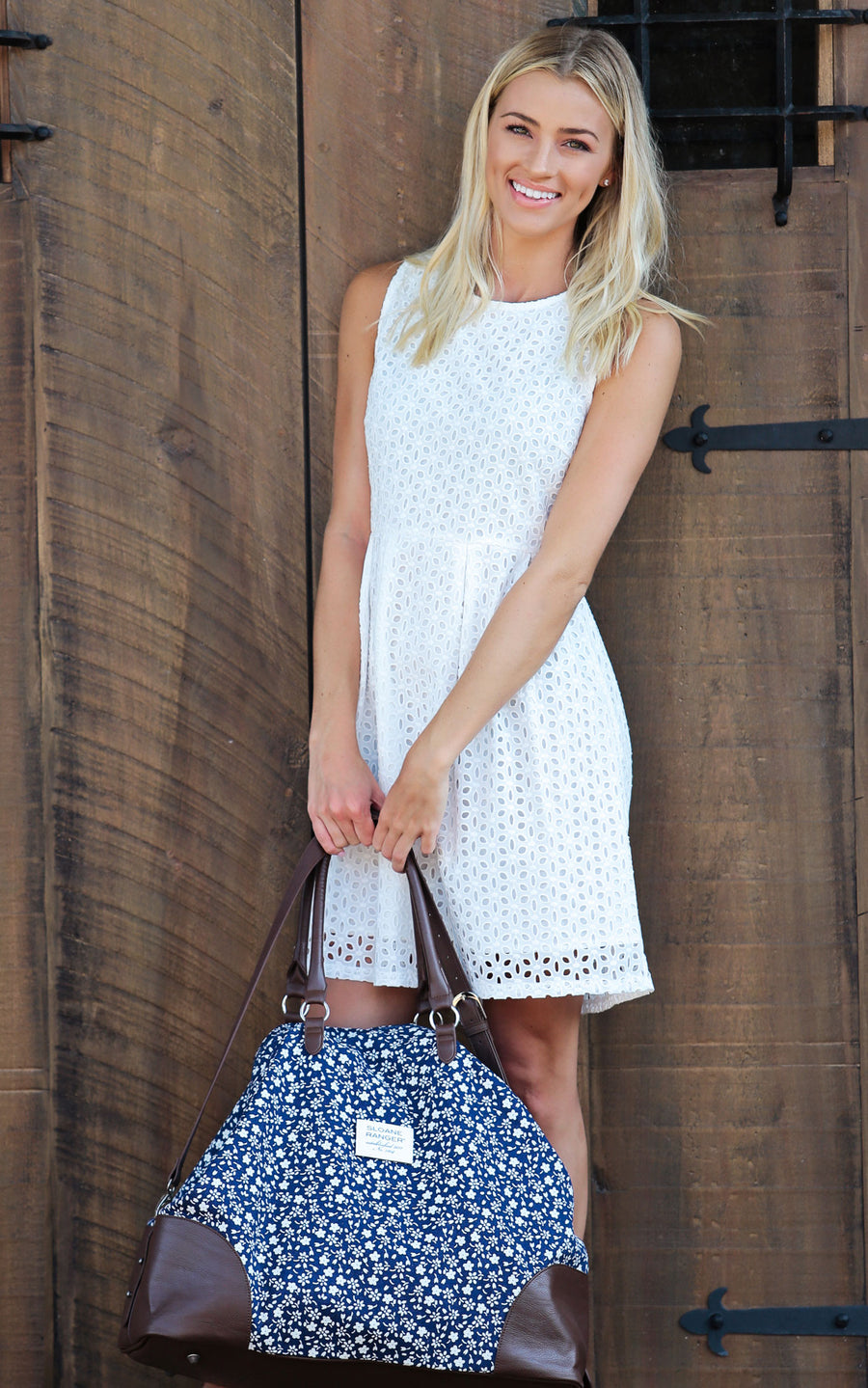 white eyelet darcy sleeveless fit and flare dress.