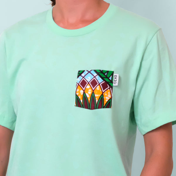 Close up of a floral patterned chest pocket on mint green t-shirt