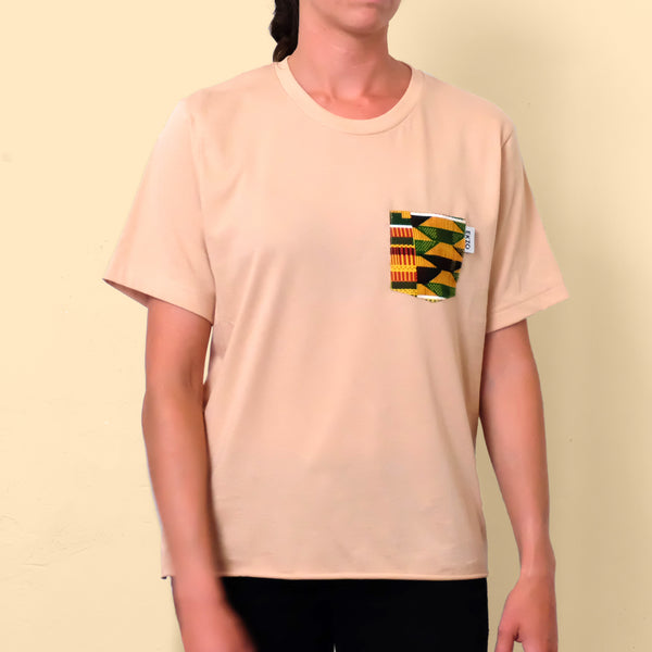 Woman wearing tan t-shirt with African print chest pocket