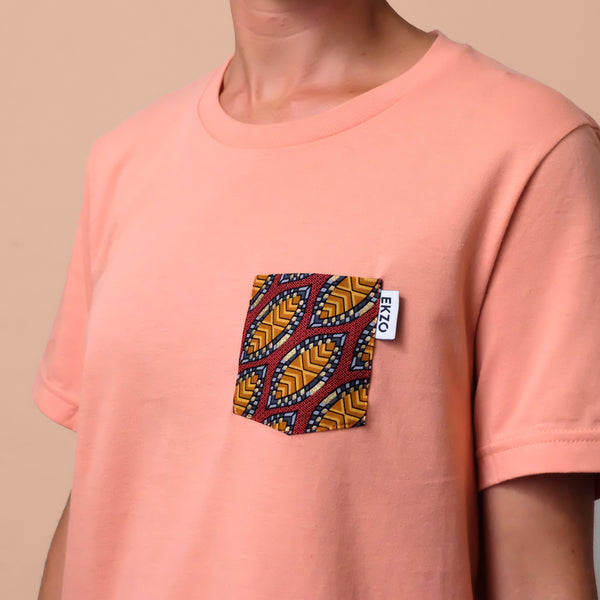 Close-up of wax fabric chest pocket on a salmon colored t-shirt