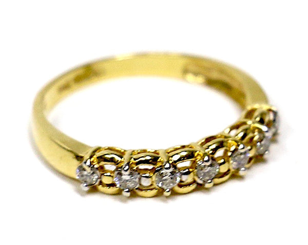 0.20 CT. Seven Stone Looped Diamond Wedding Band in 14K Yellow Gold