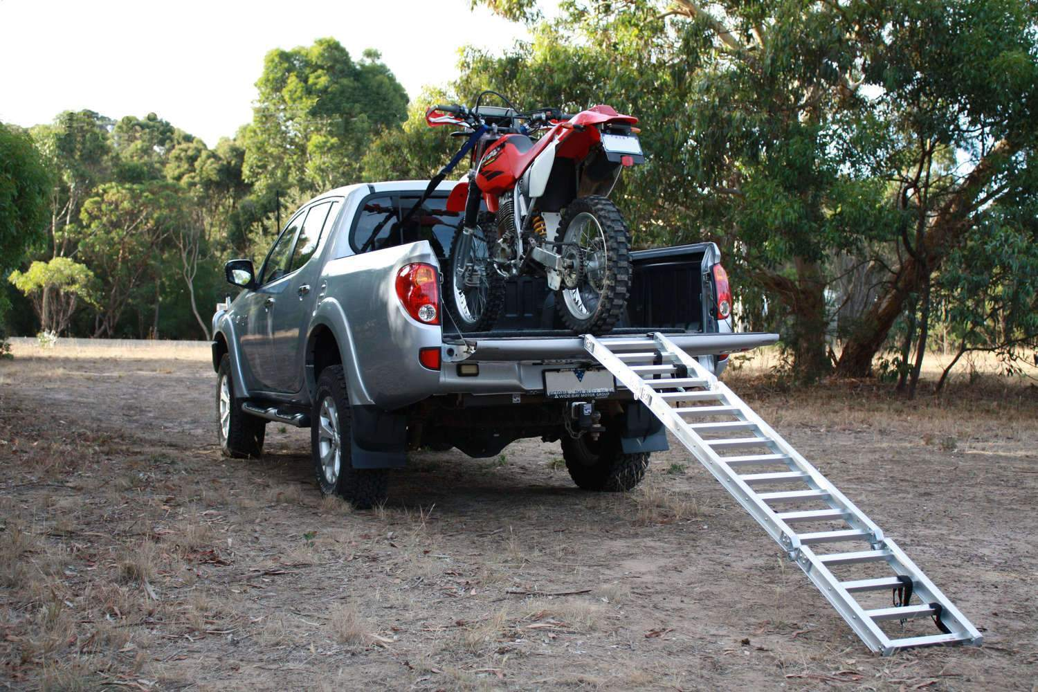 motorcycle loaded on a ute with ramp
