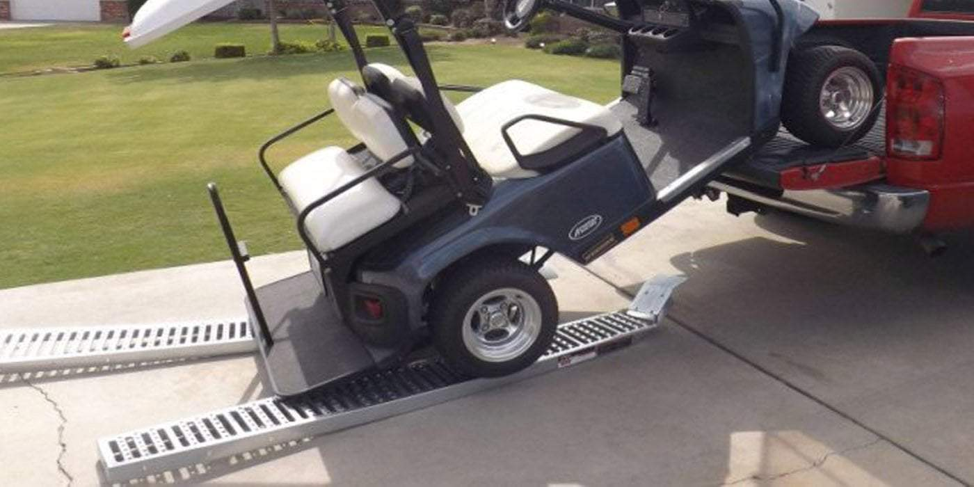 golf cart failed loading a ute ramps scattered on the ground