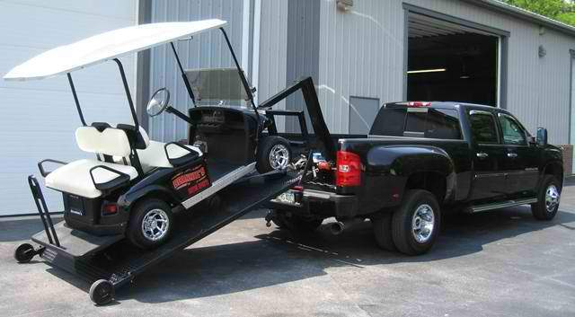 black golf cart loading a ute