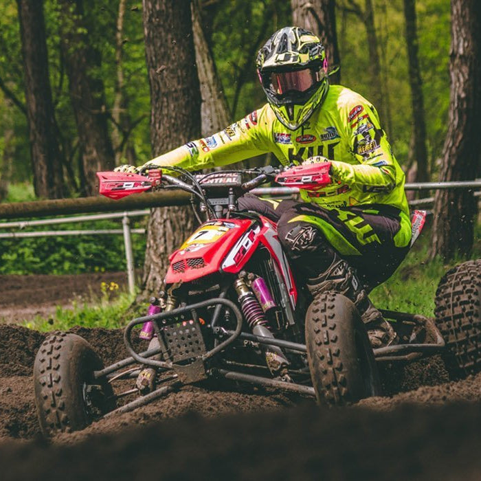 a person riding an atv in the woods