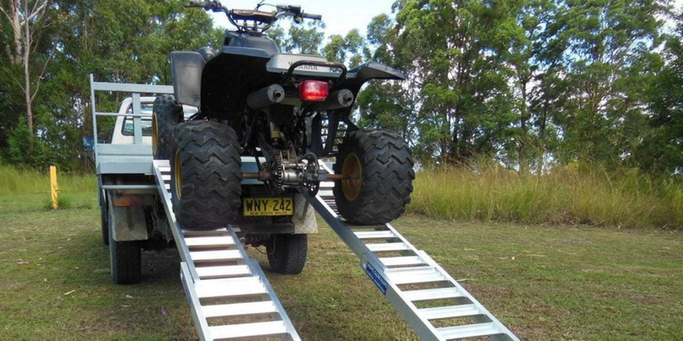 ATV loading a ute on a ramp