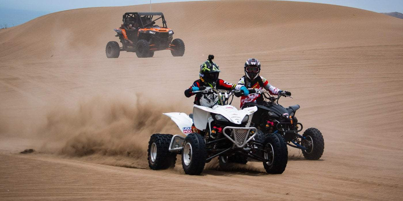 two person riding ATV on a desert