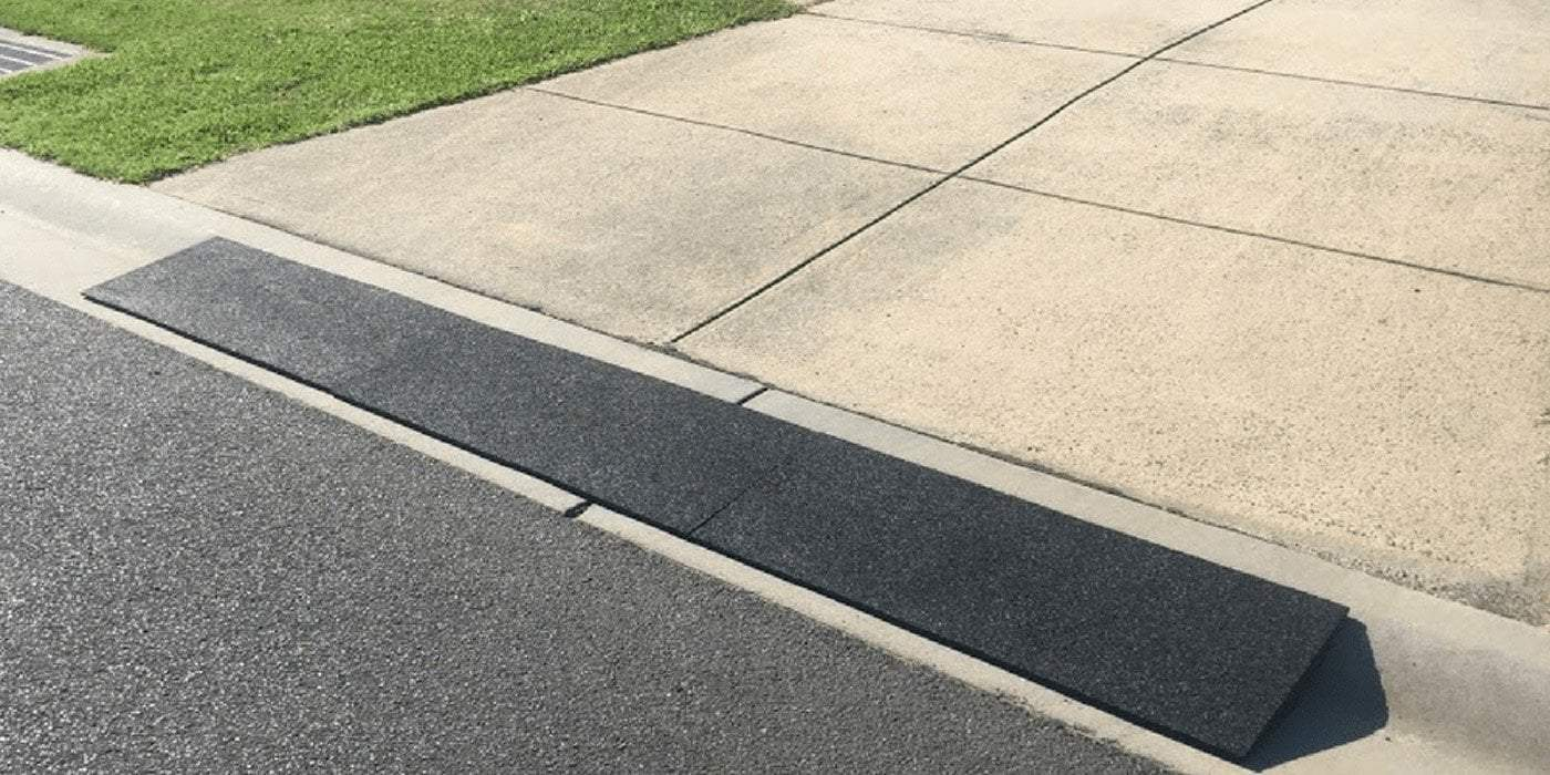kerb ramp installed between driveway and road