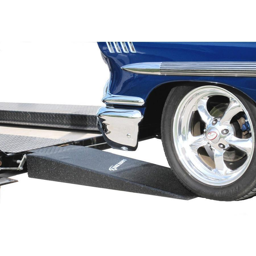 Car and truck loading ramps. Car wheel on ramp to trailer