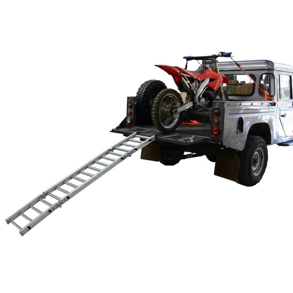 motorcycle ramp on white ute with red dirtbike