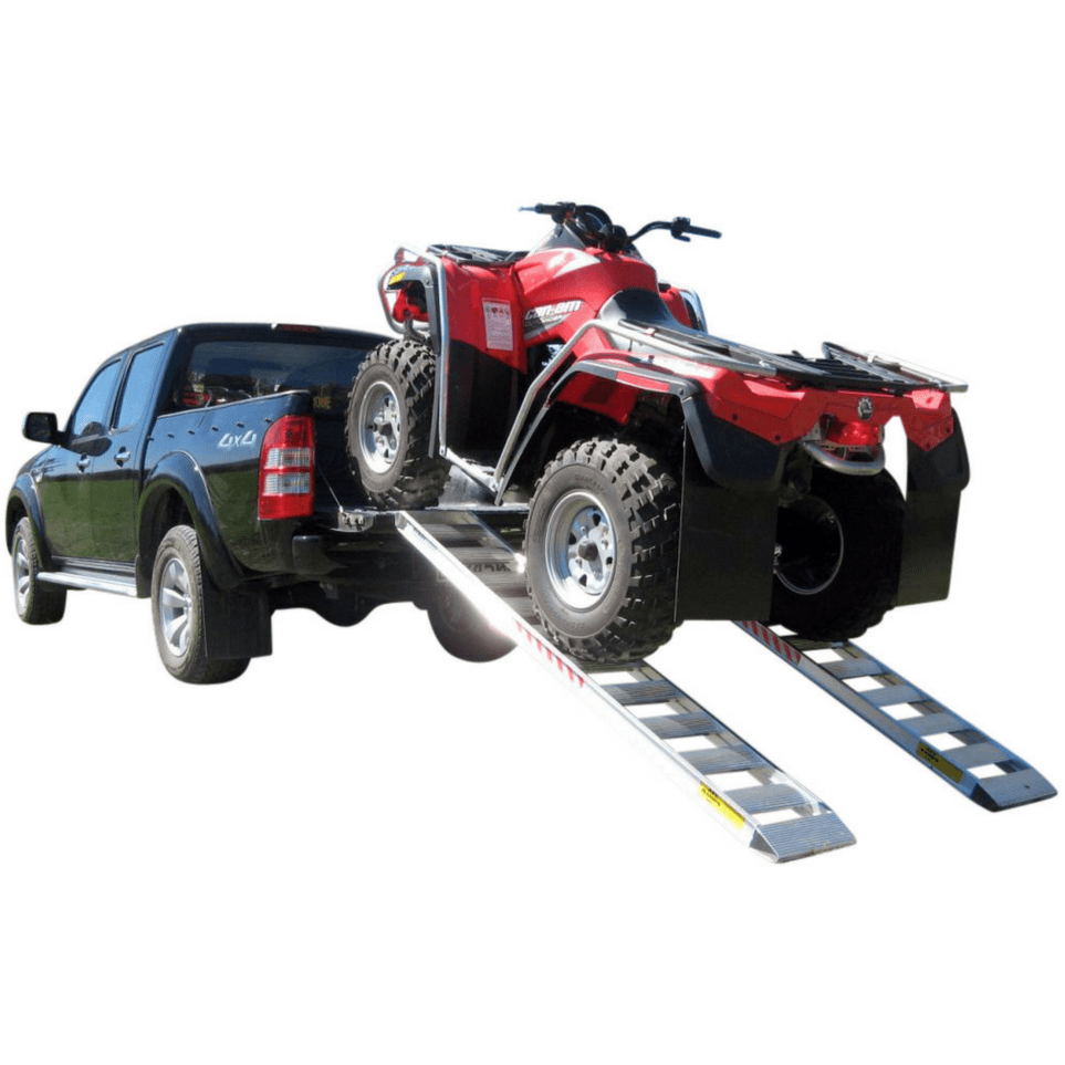 red atv driving up aluminium ramps onto black ute