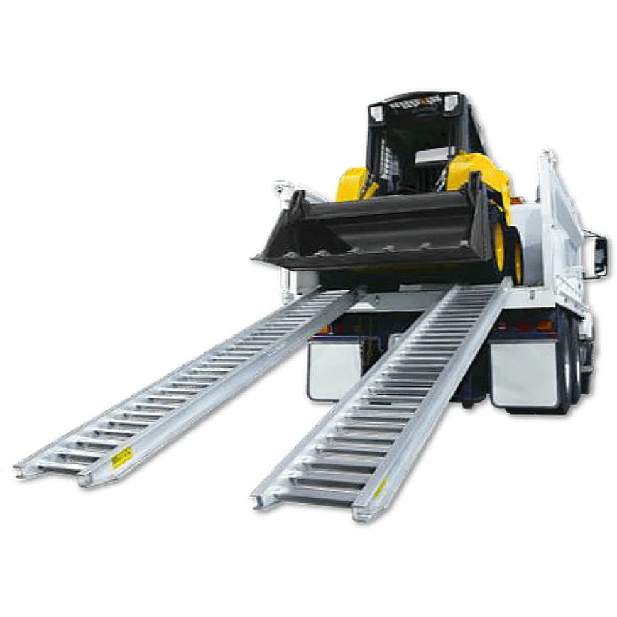 Construction Loading Ramps on truck with yellow skid steer loader from Ramp Champ