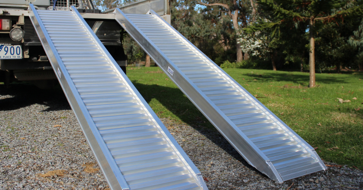 Image of the Heeve 2.5-Tonne 2.3m x 380mm Aluminium Loading Ramps on the rear of a ute