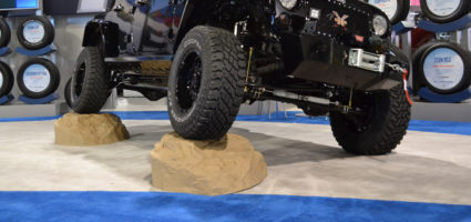 Jeep up on two Race ramps show rocks