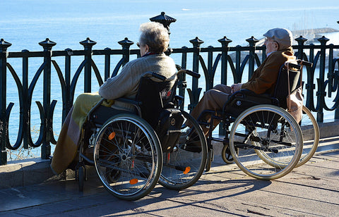 Old couple on their wheelchairs