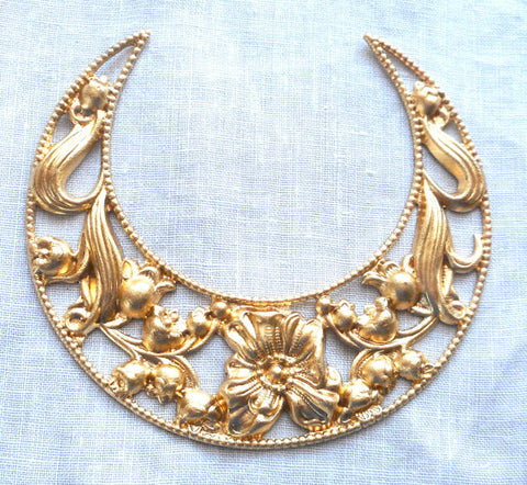 Large ornate crescent brass stamping