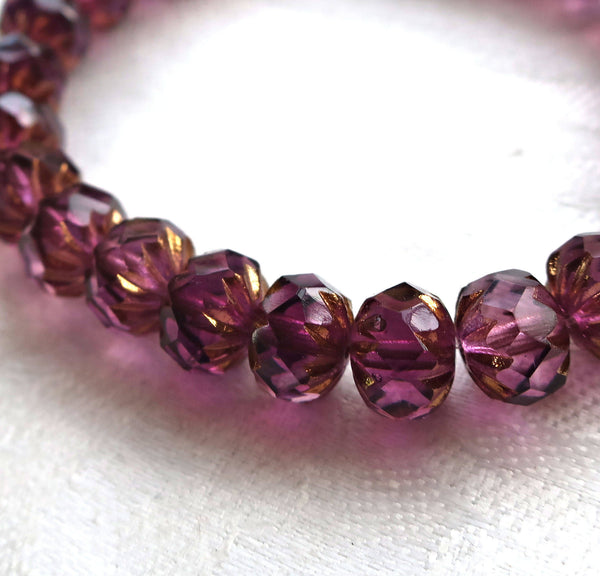 Five Czech glass faceted cruller beads. 6 x 9mm transparent amethyst, purple with a gold wash finish, carved donut beads 06701