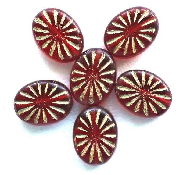 Five 14 x 11mm oval Czech glass sunburst beads, transparent ruby red, garnet, beads 5mm thick with gold accents front and back carved C53101