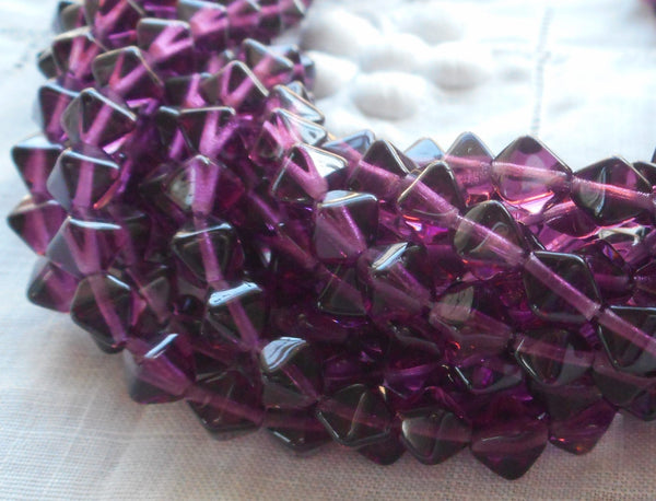 Fifty 6mm Amethyst bicones, Purple pressed glass Czech bicone beads C7501 - Glorious Glass Beads
