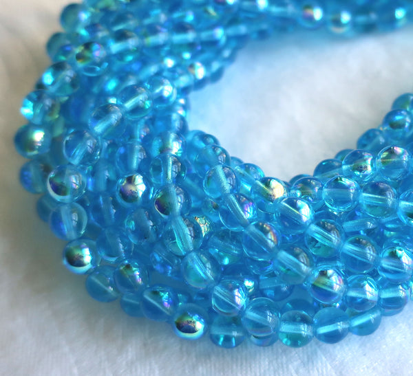 Lot of 50 6mm Czech glass beads, Aqua Blue AB smooth round druk beads C3750 - Glorious Glass Beads
