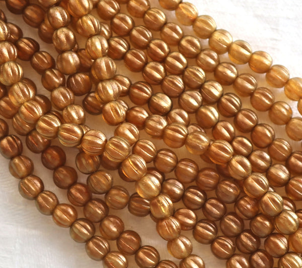 Lot of 50 5mm Czech glass melon beads, Halo Samdalwood, orange, sienna or burnt umber with a golden glow C51150 - Glorious Glass Beads