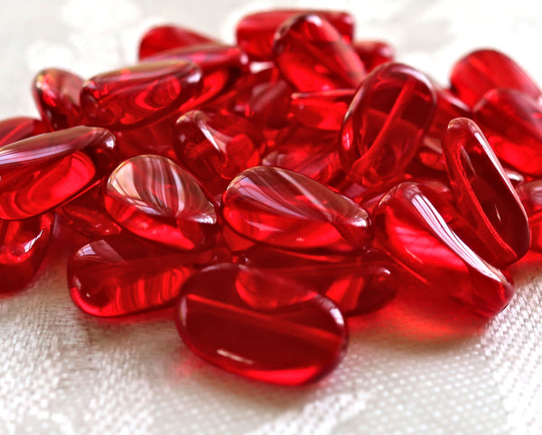 Lot o 25 transparent Siam Red slightly twisted oval Czech Glass beads, 14mm x 8mm pressed glass beads C0425