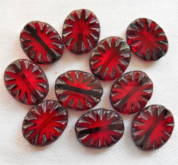 Ten 14 x 10mm oval transparenrt ruby red, garnet, carved, table cut, picasso Czech glass sunburst beads, front and back carved C52101