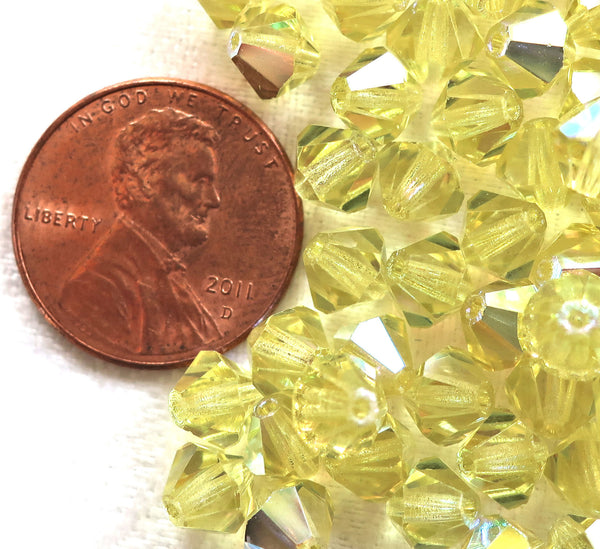 Lot of 24 6mm Czech Preciosa Crystal Jonquil AB glass faceted bicone beads, yellow AB bicones 11301 - Glorious Glass Beads