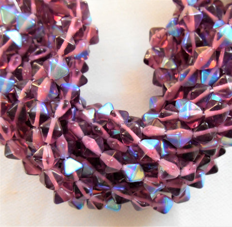 Fifty 6mm Amethyst AB bicones, Purple AB pressed glass Czech bicone beads C2701