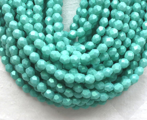 Lot of 50 4mm Opaque Aqua Glow Turquoise Czech glass beads, firepolished, faceted round beads, C3601