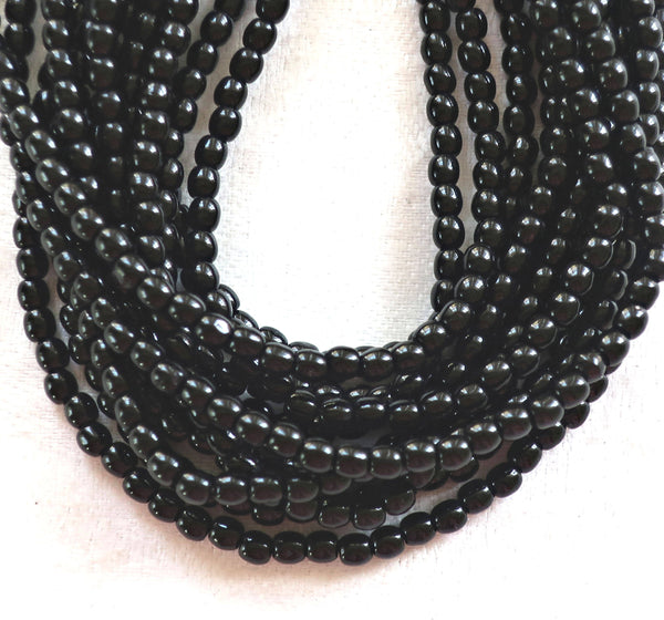 Lot of 100 4mm jet black Czech glass druks, smooth round druk beads C4301 - Glorious Glass Beads