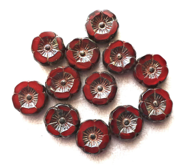 Twelve Czech glass flower beads; 12mm table cut, carved, translucent garnet red Hawaiian flower beads with a silver picasso finish C52201