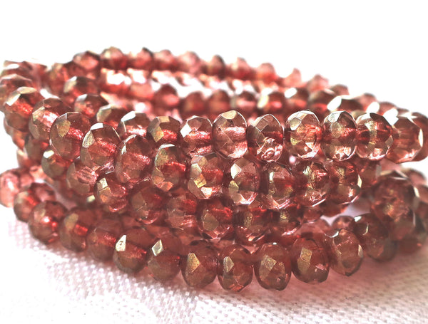 Lot of 30 small pink luster puffy rondelle beads, 3mm x 5mm faceted Czech glass rondelles 91101 - Glorious Glass Beads