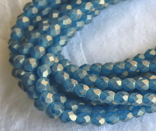 Lot of 50 4mm Sueded Gold Capri Blue Czech glass beads, firepolished, faceted round beads, with a frosty gold finish , C9625 - Glorious Glass Beads