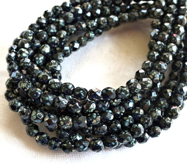 Lot of 25 8mm Jet black Czech glass beads with a picasso finish, speckled, firepolished, faceted, round beads C5725