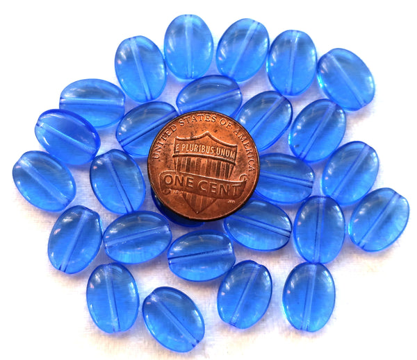 Lot of 25 transparent sapphire blue flat oval Czech Glass beads, 12mm x 9mm pressed glass beads C7425