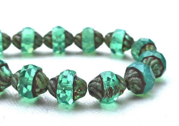 Five light teal Czech glass turbine beads. 11 x 10mm light slightly milky blue green faceted saucer beads with a Picasso finish C01101