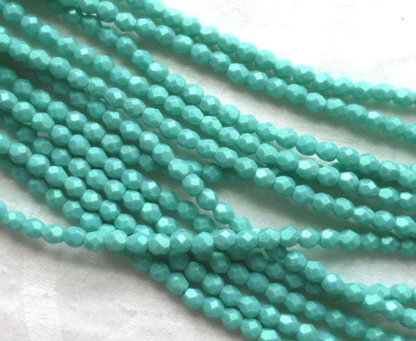 Lot of 50 4mm Opaque Aqua Glow Turquoise Czech glass beads, firepolished, faceted round beads, C3601 - Glorious Glass Beads