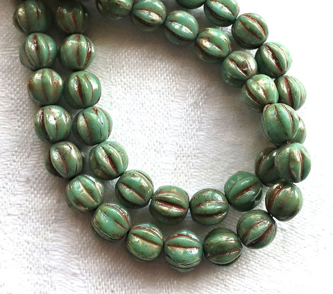 Lot of 25 6mm pressed Czech glass melon beads, pea green picasso beads with coral accents C0901