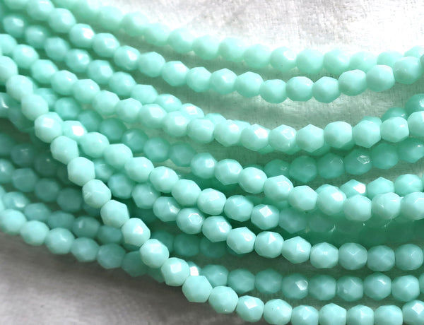 Lot of 50 4mm Opaque Pale Jade Green Czech glass beads, opaque light green faceted. firepolished round beads C8501 - Glorious Glass Beads