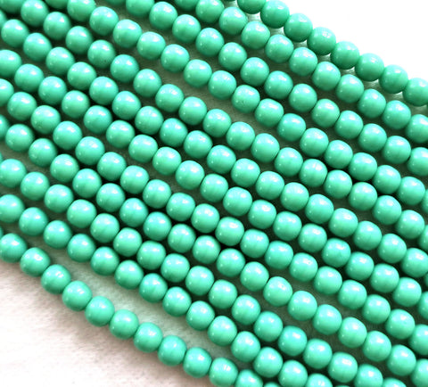 Lot of 100 4mm Opaque Turquoise Green Czech glass druks, smooth round druk beads 40101 - Glorious Glass Beads